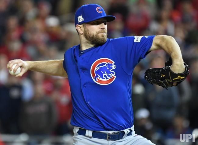 Chicago Cubs reliever Wade Davis throws in the eighth inning