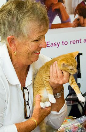 Jackie is a natural with our felines!  Here she is showing off one our kittens at a PetSmart adoption event.