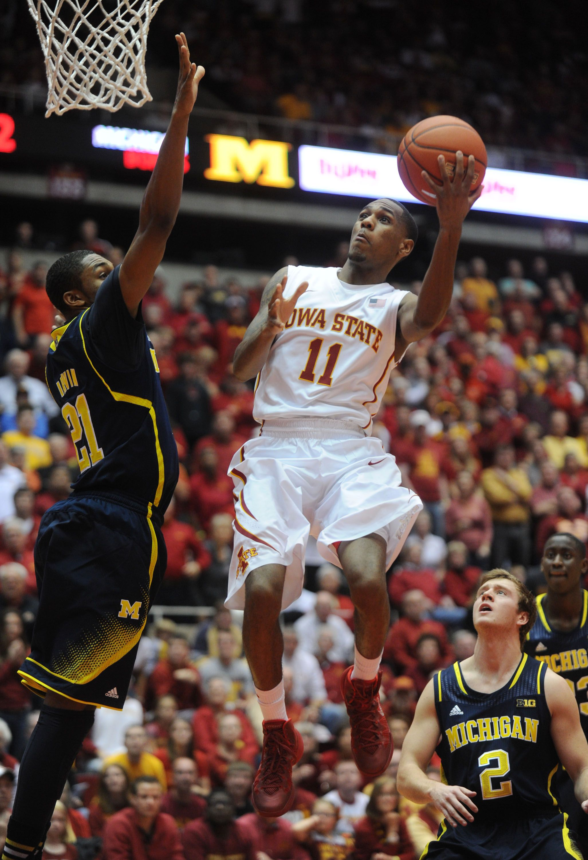 Iowa states monte morris lays up the ball over michigans