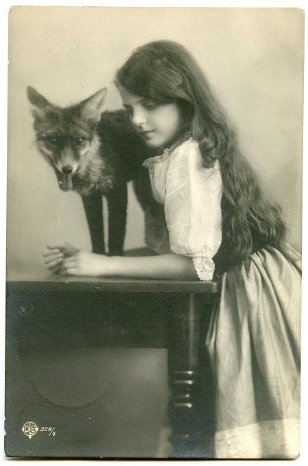 Savannah when she was young, when her dad was around. They lived next to the woods so she had a fox friend.