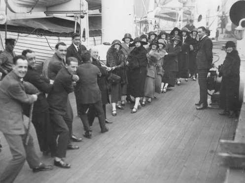 ...engaged in a round of tug of war... - Courtesy of Cunard
