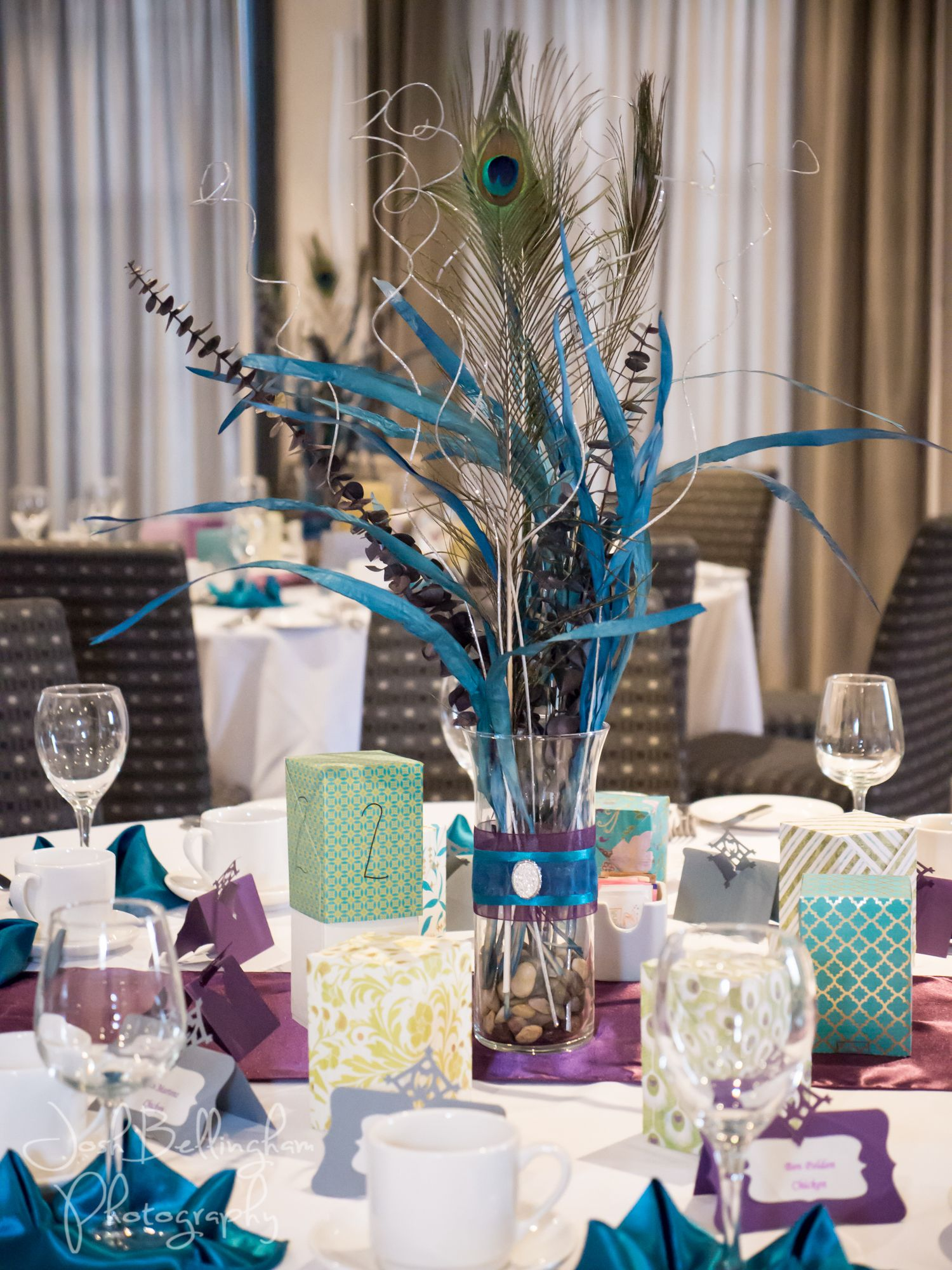 Detail of Purple and teal colors for wedding. Guest table