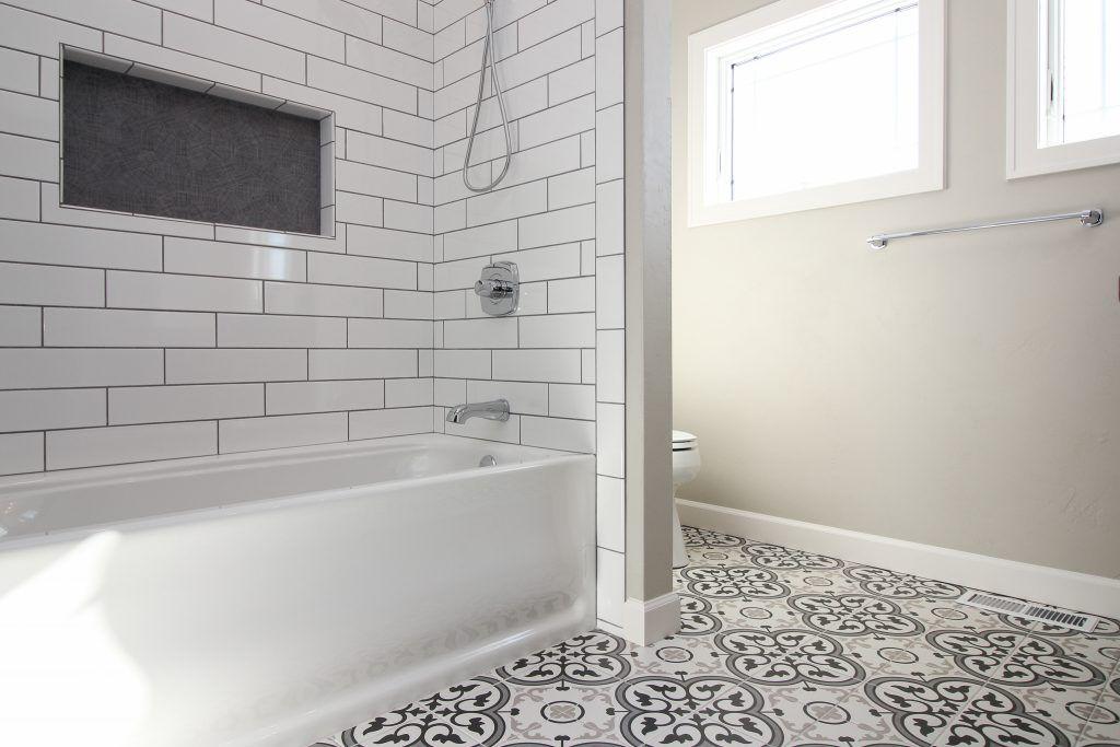 Master Bath With Mosaic Tile Flooring In 2020 Tub Surround Tile Tub Surround Bathroom Renovation