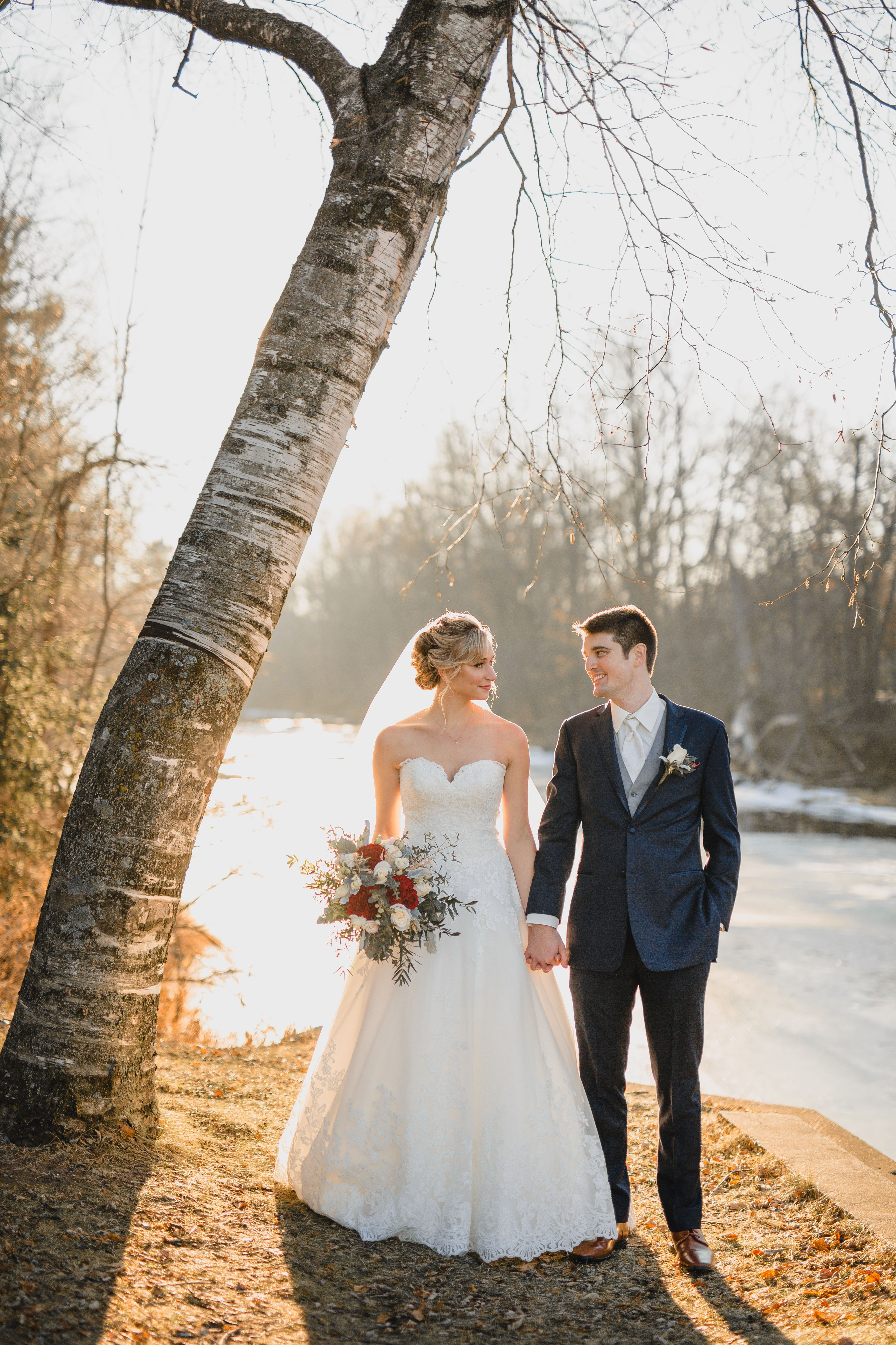 Winter Weddings In Wisconsin Can Be Really Cold But These Two Made It A Lot Warmer It Was Still Pretty Cold Though Br With Images Bride Groom Bride Wisconsin Wedding