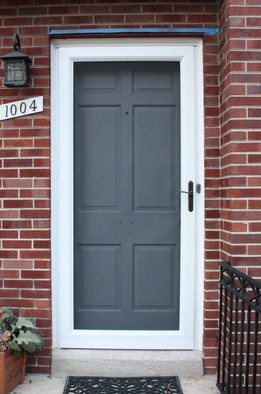 grey front door colors white frame country home with brick wall