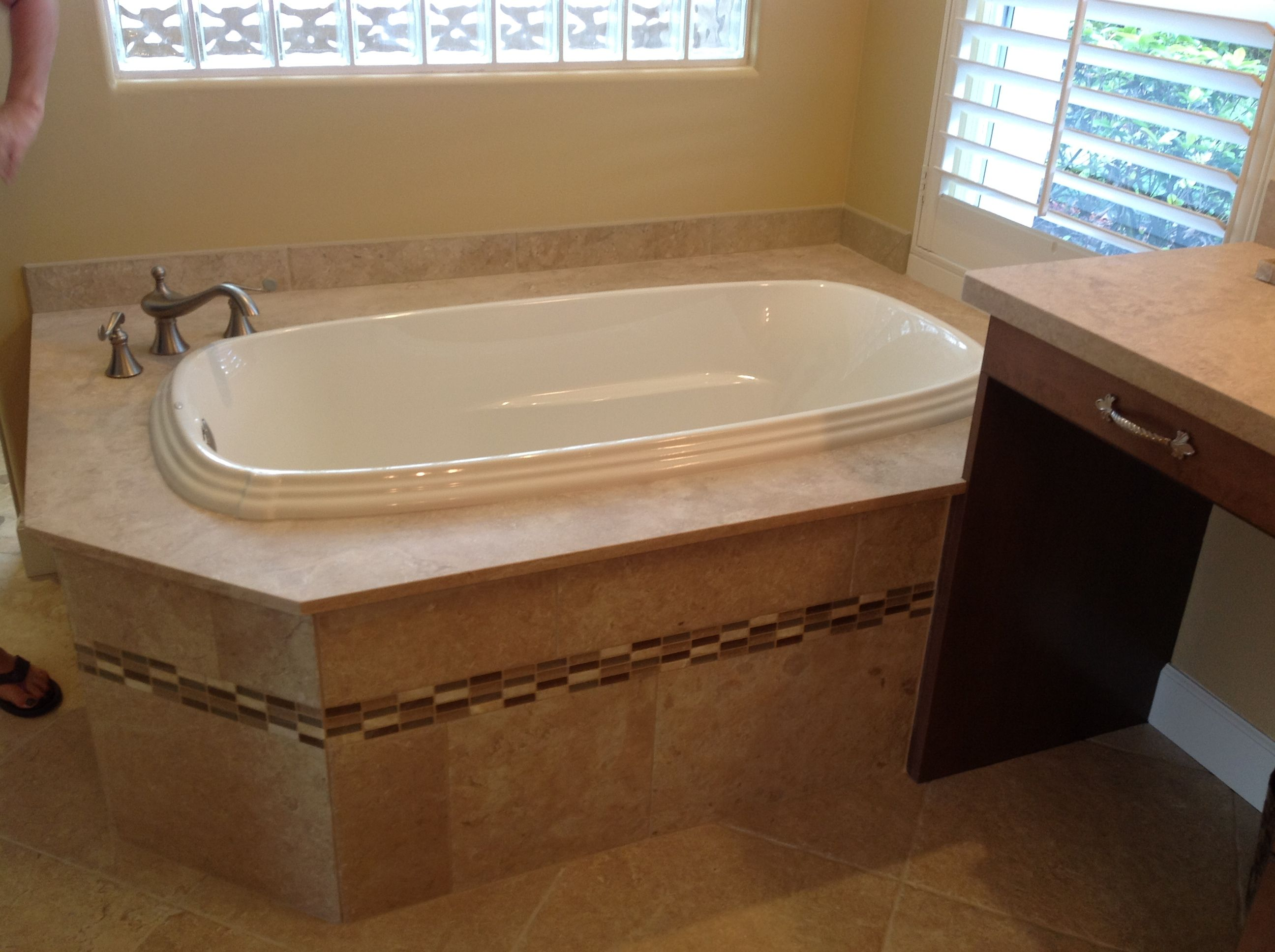 Contemporary condo bath modern bathroom chicago by jill jordan - Custom Tub Deck Constructed From The Schluter System Then Tiled With Italian Stone