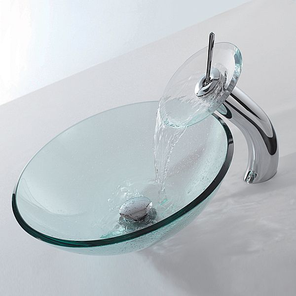 Minimalist Waterfall Faucet combined with a beautiful glass vessel sink  might be just a simple appliances for your bathroom , but this one has a  moder