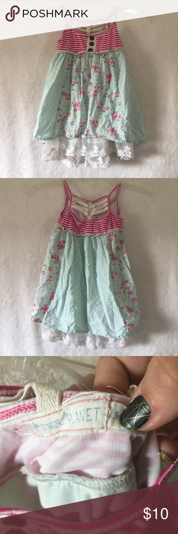 Free planet girls sz 5 boho dress So adorable! This pretty little dress is perfect for any flower child. Pink striped top with button details, a floral and polka dot skirt and lace peeking out the bottom. Unique cage back. There is a small stain on the back as shown. May come out. free planet Dresses Casual