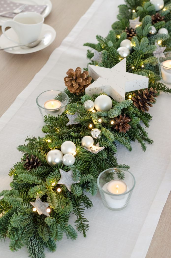 Photo of Fir garland with fairy lights tie Christmas decorations for the table