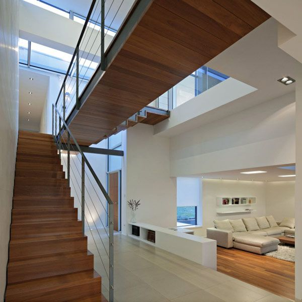 Contemporary House Design By Studio Gorgeous T Shaped Floor Plan Residence Interior Wooden Staircase SQUAR ESTATE Architecture Inspiration