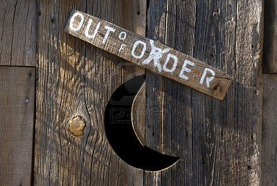 A close up of an old vintage outhouse