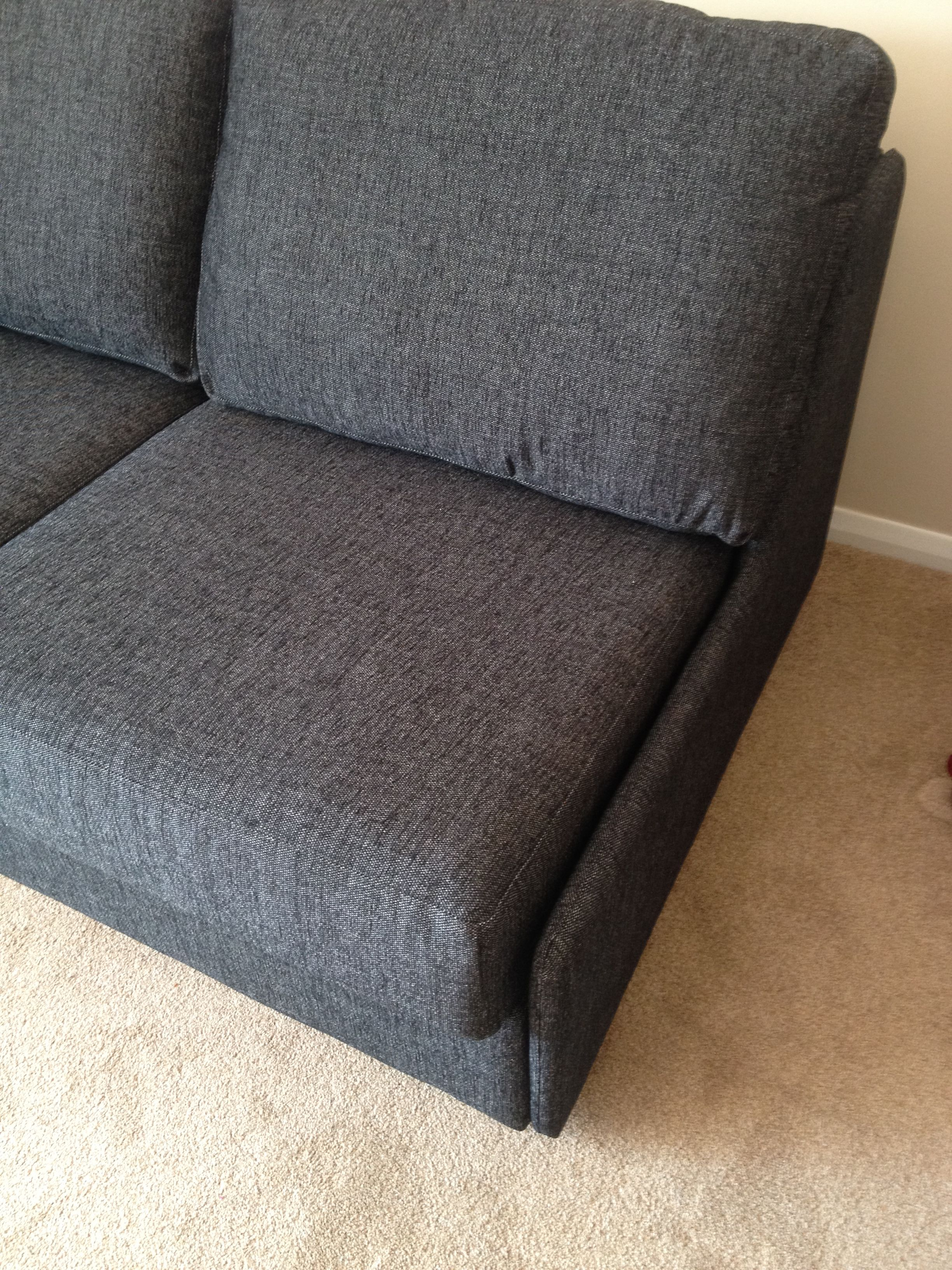 Ash sofa bed with upholstered end parts instead of arms