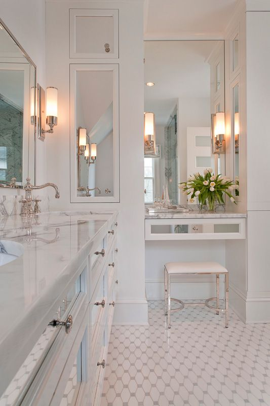 White bathroom with mirrored cabinet vanity drawers and doors. http://cococozy.com
