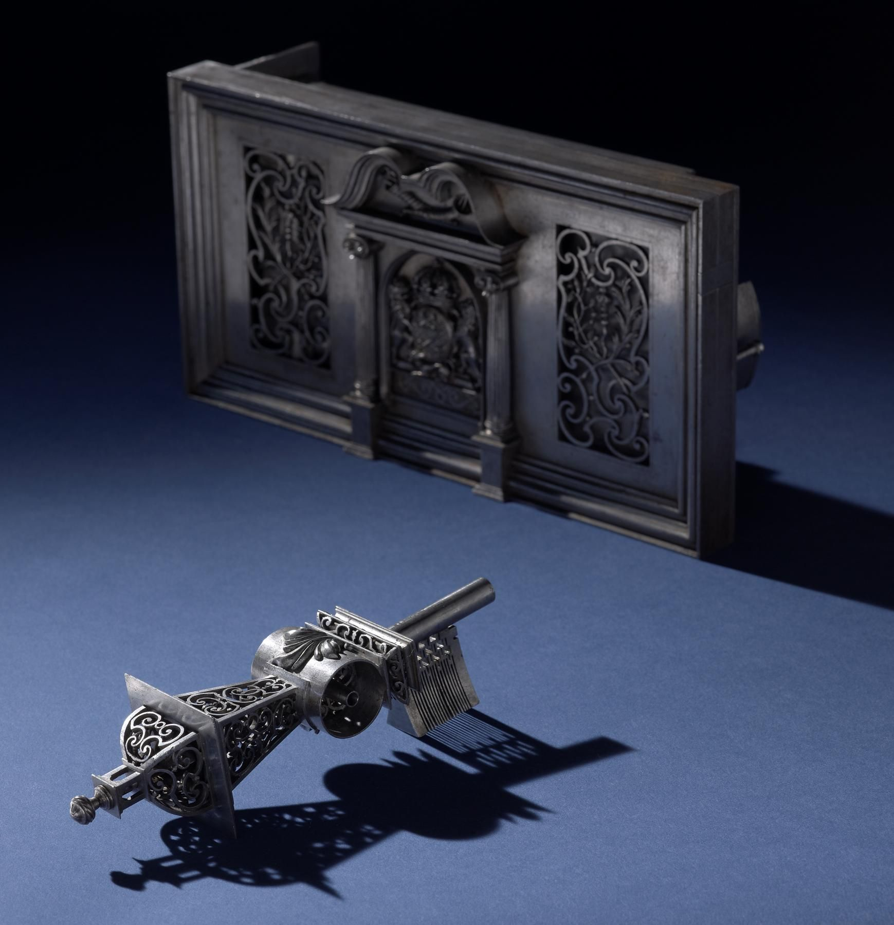 A late 17th century/early 18th century French masterpiece lock with key.