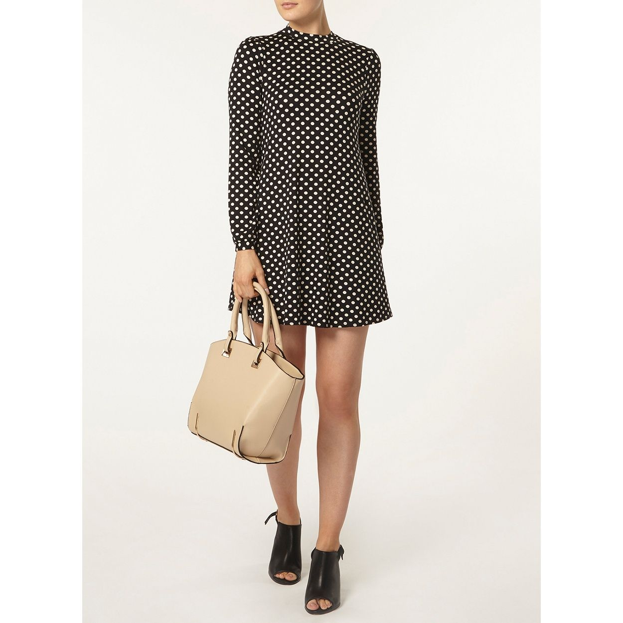 Nude and black spot swing dress with long sleeve.