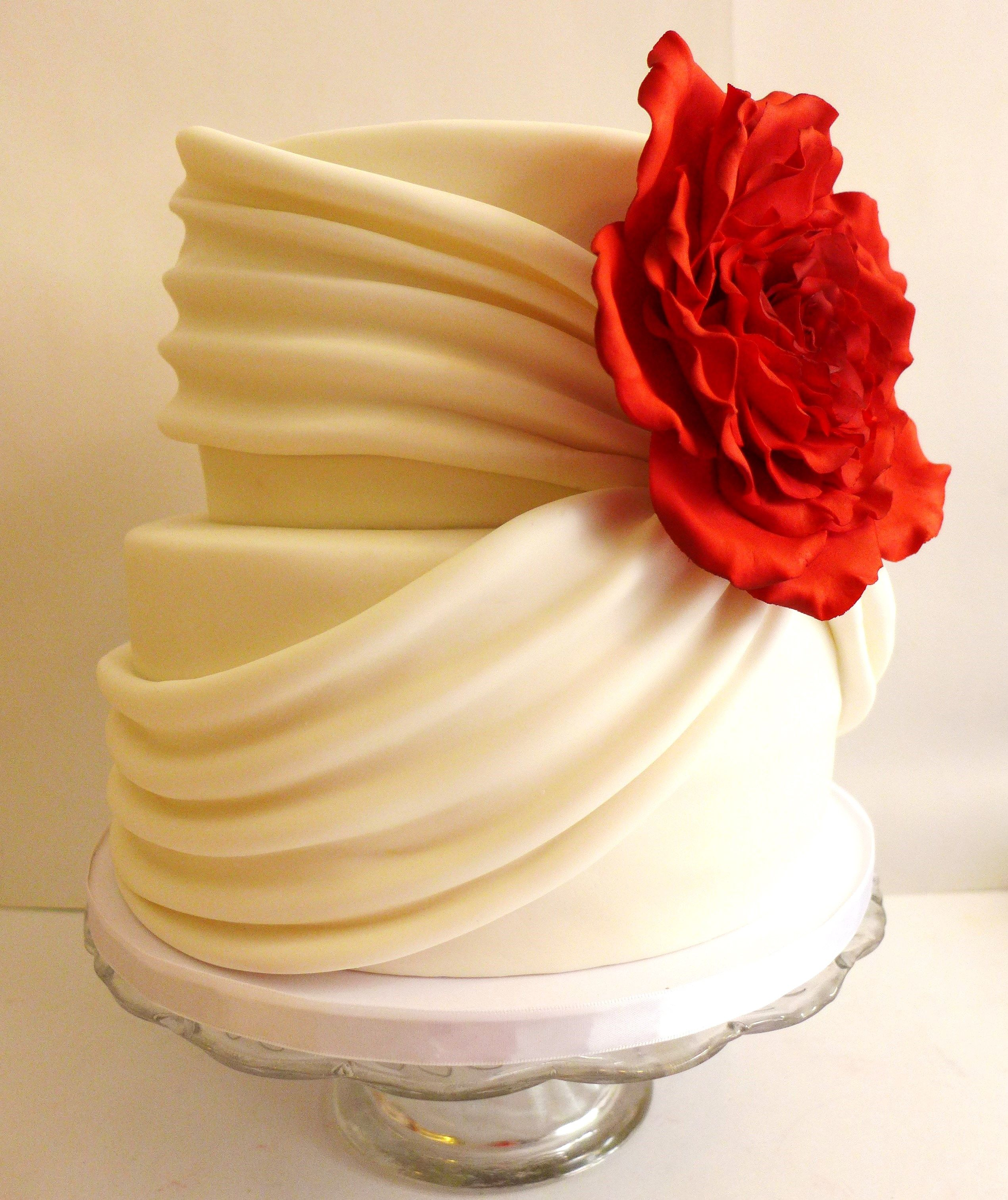 Red rose and cream ivory wedding cake, swags grecian style wedding ...