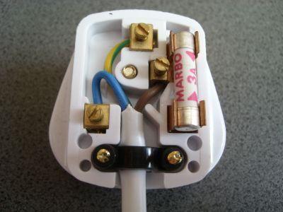 Inside one half of a three pin plug. Of course a plug has