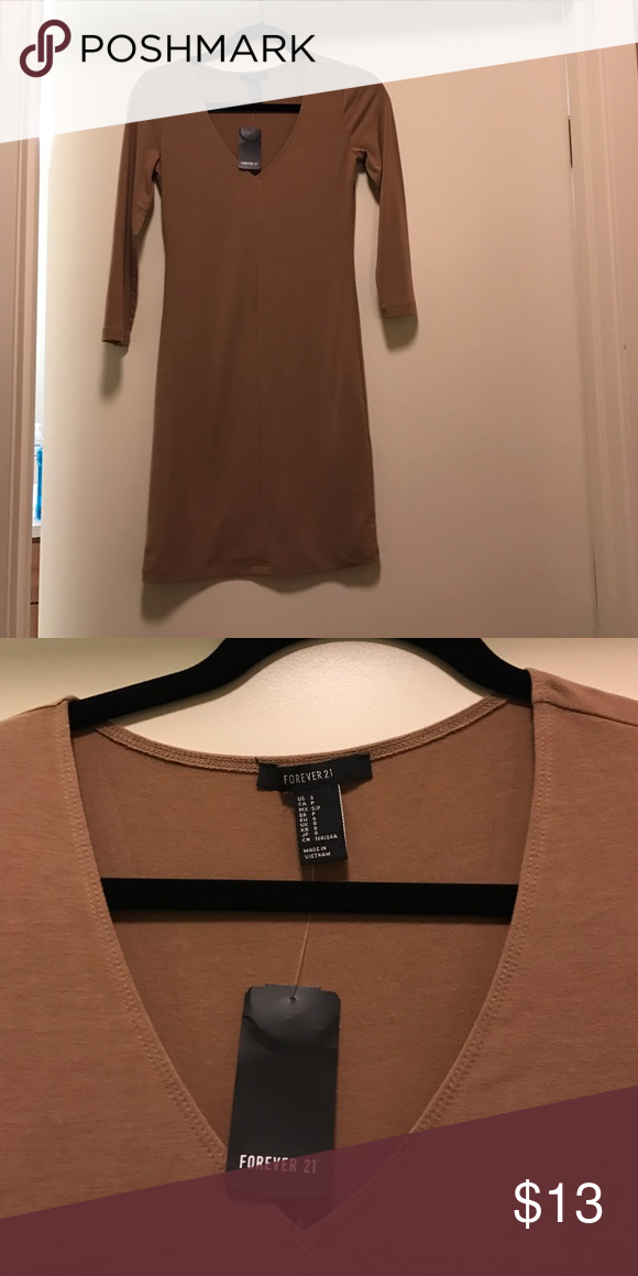 NWT Forever 21 tan nude dress NWT v-neck dress that needs a home! Bought in November and haven't worn. Dresses Mini