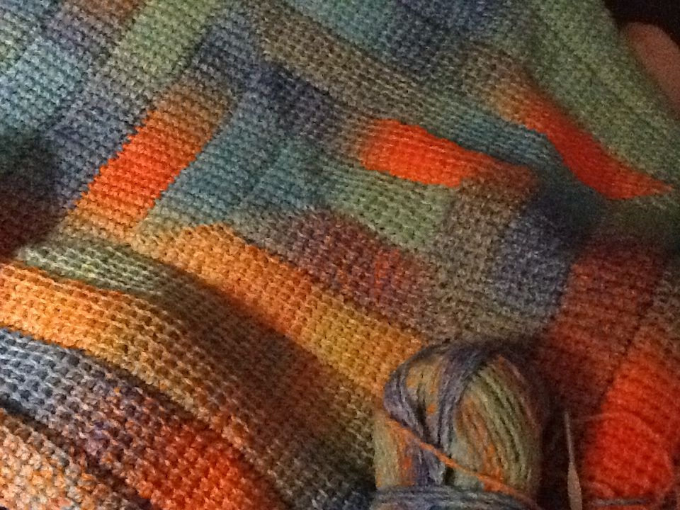 Tunisian simple stitch spiral blanket. I love using the variegated yarn!
