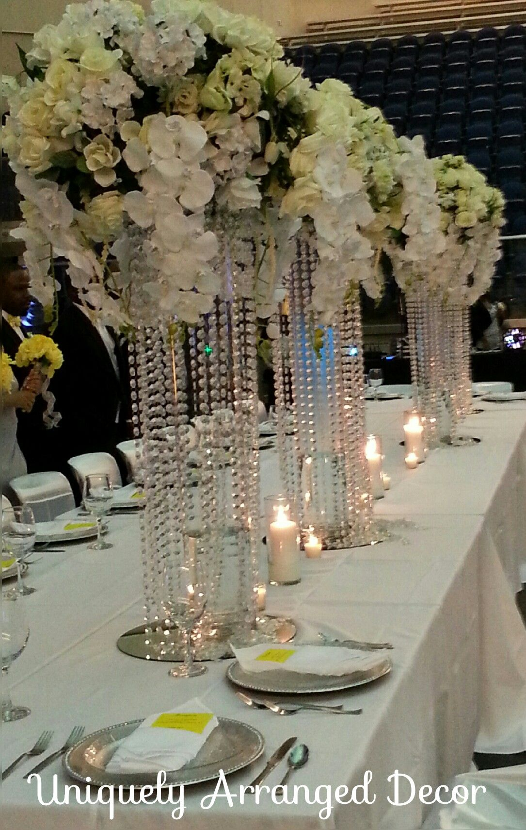 Tall bling orchid centerpieces on the wedding party