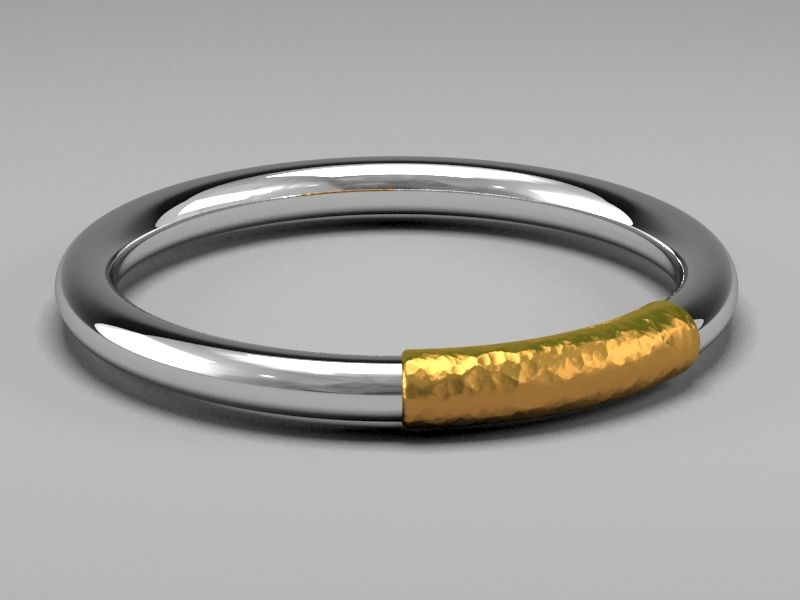 The Ring by MB. 14 carat white gold with hammered 24 carat gold band. Designed in 1992 by MB. This is the original design. The Ring is only going to be produced in a small series of 10 pieces in each color.