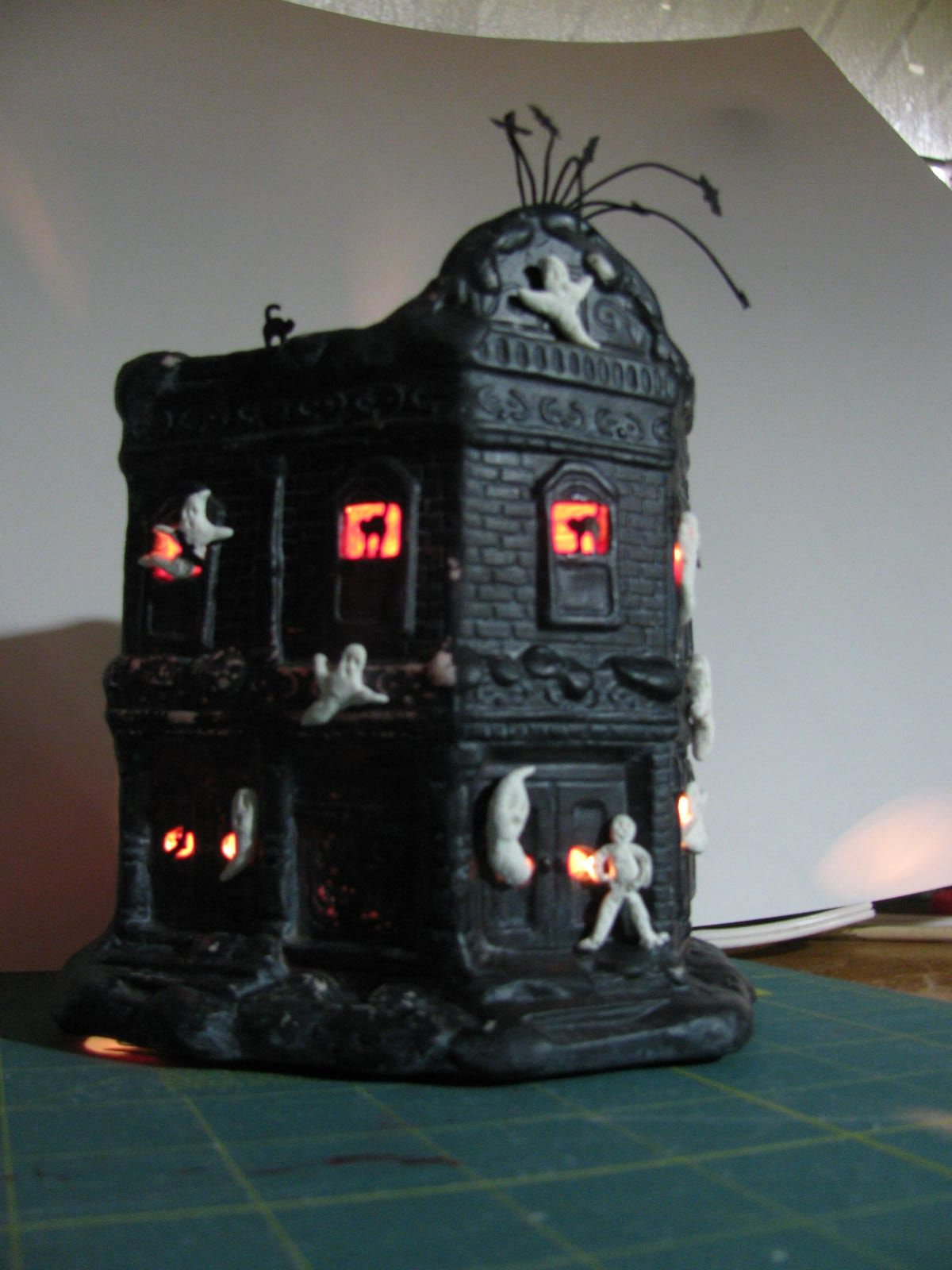 A ghost house I made for Halloween from a Goodwill store Christmas house. An idea that came from Pinerest of course. The design though was all my own.