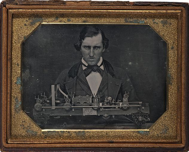 ca. 1850's, [daguerreotype portrait of a gentleman posed with an unidentified patent model] via Cowan's Auctions