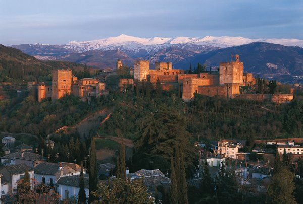 The Beautiful Sierra Nevada Mountains-Granada, Spain with the Alhambra palace in the foreground. #Mountains #travel