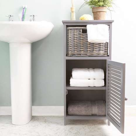 Crafted From Wood With A Panelled Design This Grey Storage Unit Features Cupboard And Woven Willow Drawer