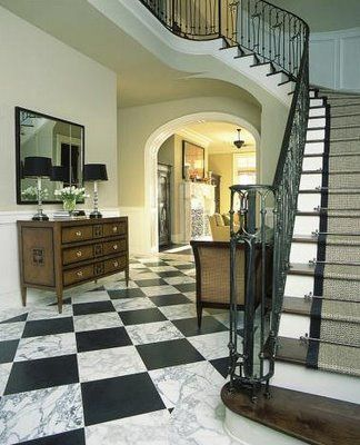 black and white marble floors. two of my favs  winding stair cases and black white marble floors