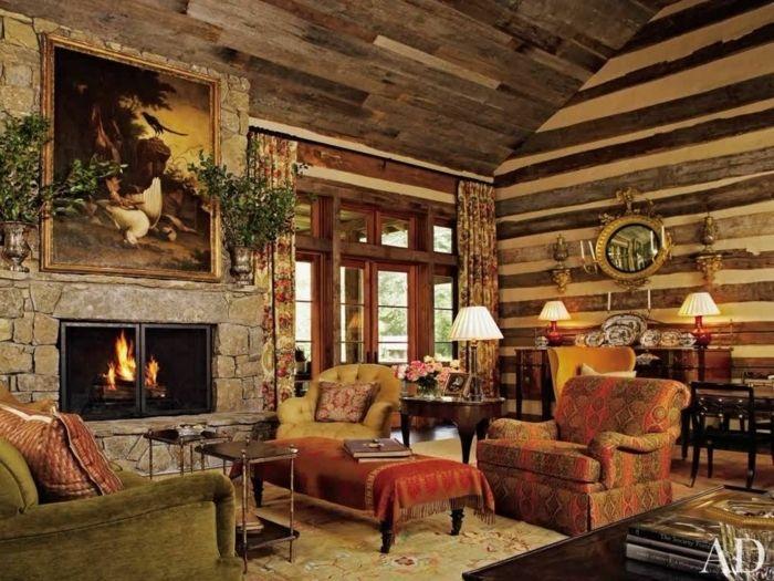 salones rusticos salon con chimenea de piedra rojo y amarrillo cuadro plantas - Salones Rusticos Con Chimenea