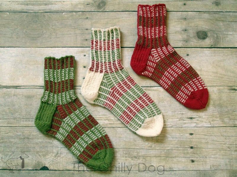 """It's a little non traditional to make a set of three socks, but with three colors of yarn, I wanted to see how the stripes looked in each pattern position. These socks are sized for an average woman's foot and are perfect for holiday gift giving."""