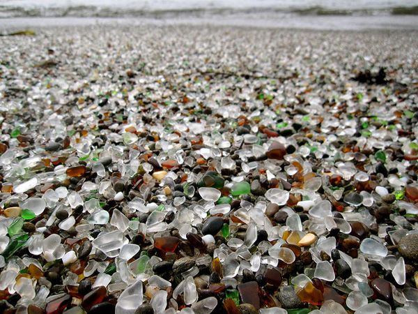 This is a beach in California where people threw their garbage. And then no one could clean up the glass because it was tiny. Luckily the ocean took care of it for them and made it into the most wonderful beach in the world.