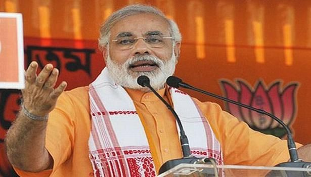 Modi asks BJP workers to yank out Congress from helm