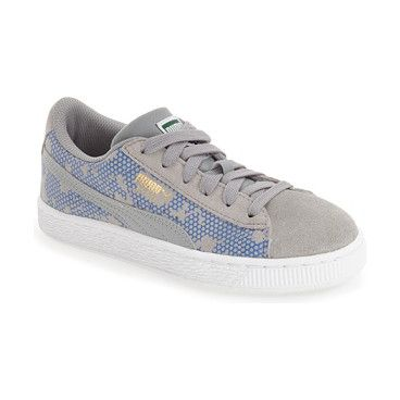 newest ad09a d933c  night camo  sneaker by Puma. Classic stripes swoop across the camo-patterned  suede of a sporty, retro-cool sneaker.