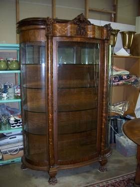 Tiger Oak Curved Glass Curio Cabinet with Lionu0027s Head and Claw Feet