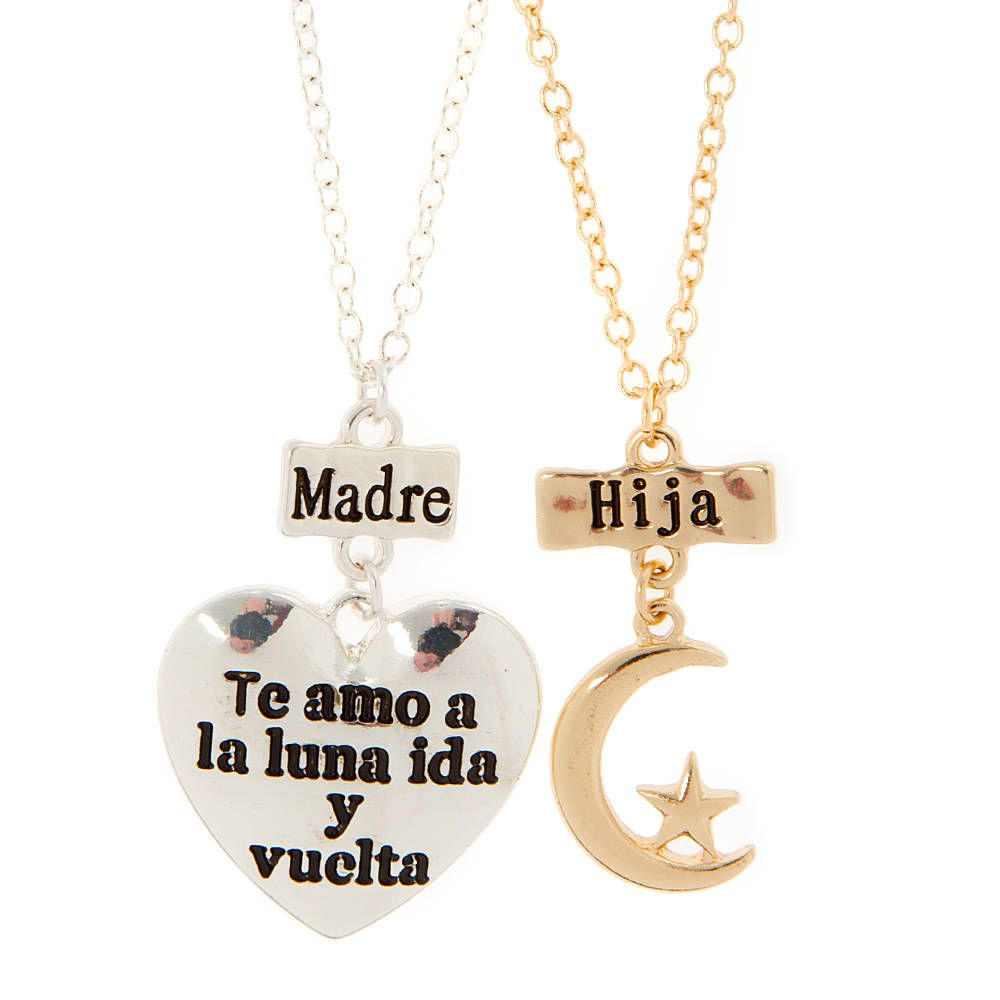 """<P>Show the special bond you share with your mom with this set of pendant necklaces. The necklace for mom features a silver heart with the phrase """"Te amo a la luna ida y vuelta"""" while the daughter's is gold and features a crescent moon and star.</P><P>Demuestra el lazo especial que tienes con tu Mama con este juego de collares. El collar para Mama tiene un corazon de plata con la frase """"te amo a la luna ida y vuelta"""" y el collar de hija es de oro con una luna y estrella.</P><UL><LI>Pendant…"""
