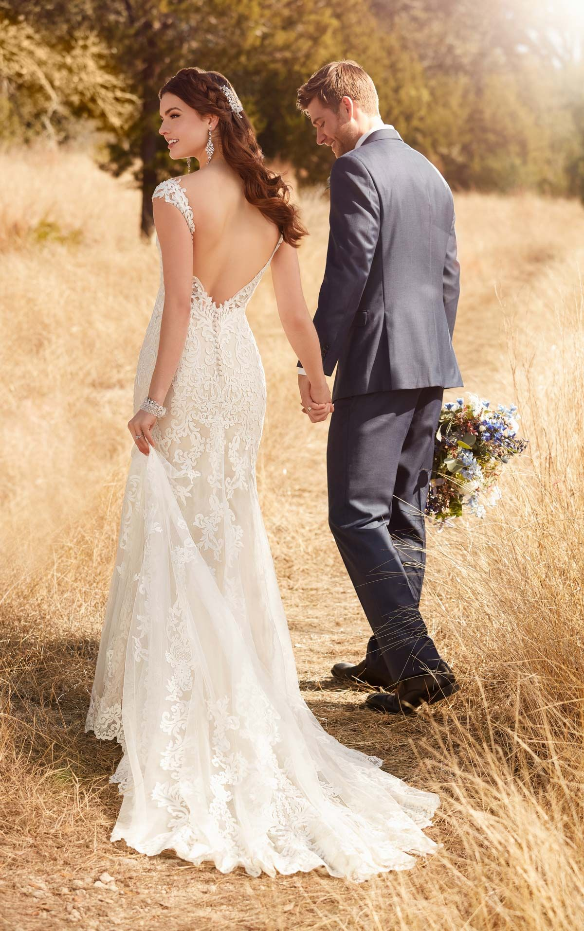 This backless wedding dress is the ethereal wedding dress brides love! A relaxed column shape feels casual while remaining true to classic bridal style.