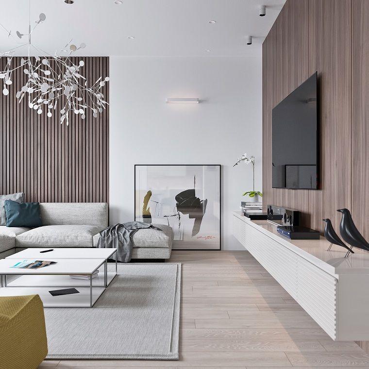 Salotto moderno con una parete di legno e mobile bianco