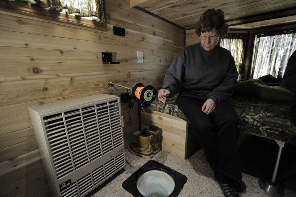 Fancy fish houses for upscale anglers buzzers for Ice fishing rattle reels