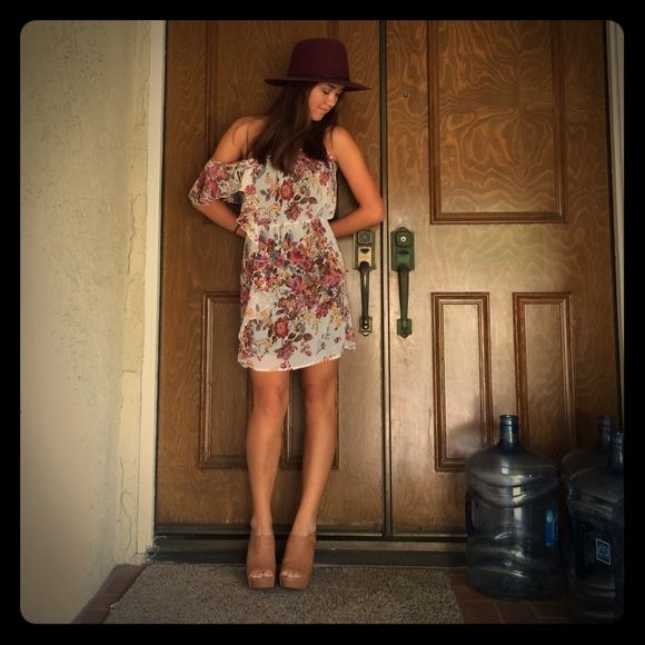 Floral Dress  Light floral dress with ruffle off the shoulder sleeve and spaghetti strap. Wet Seal Dresses