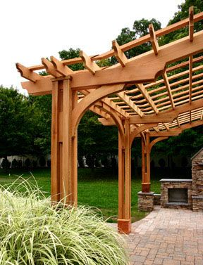 Detailed arches and peaks define this large pergola designed to provide significant shade while framing the outdoor space.