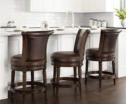 Swivel bar stools, like these leather versions, are both functional and stylish.