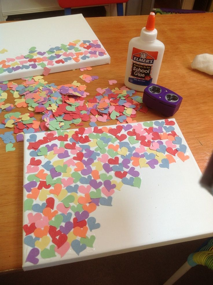 Use various punched shapes or just one glue to a sturdy board valentines heart art project canvas frame glue heart punch different colors construction paper solutioingenieria Choice Image