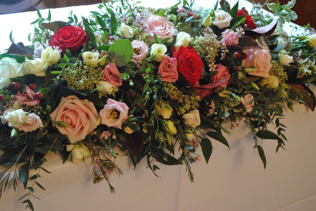 Long And Low Table Arrangement Nunsmere Hall By Laurel Weddings Flower Decorations