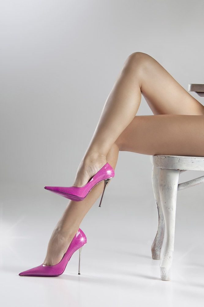 Sexy italian woman with high heels stock photo