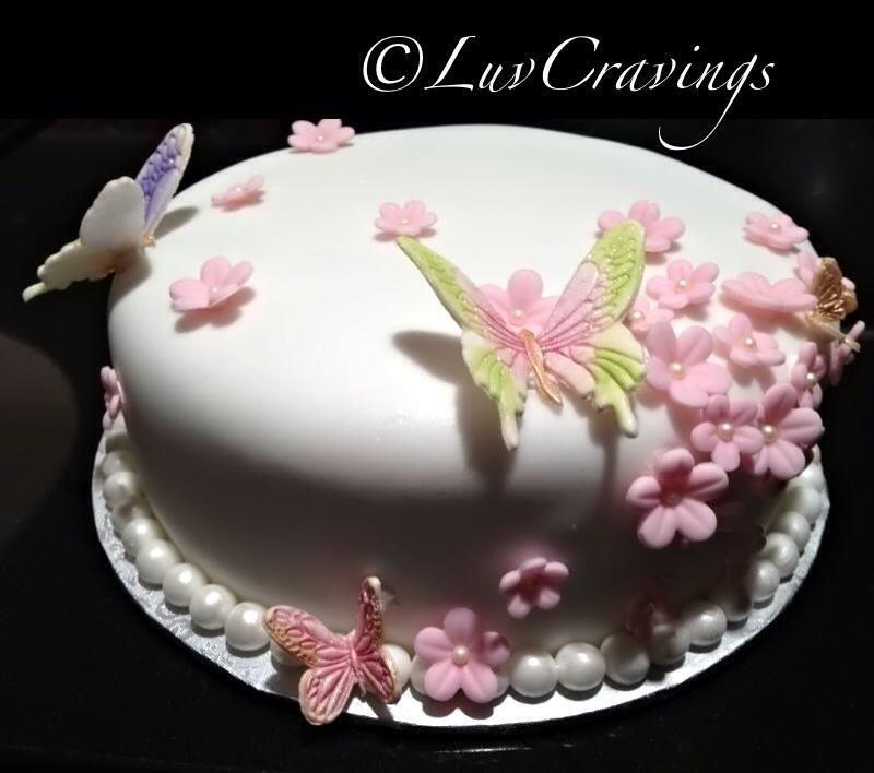 Butterfly cake with daisies all around vancouver
