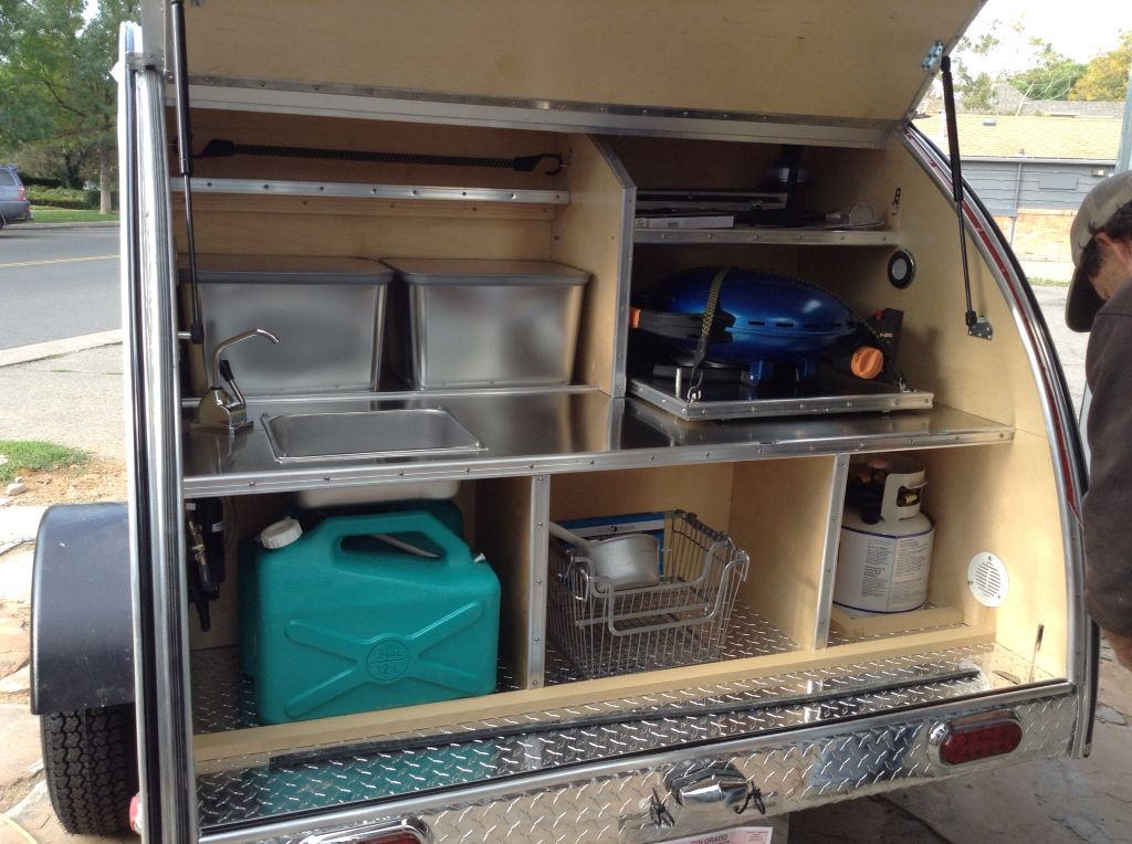 Stainless steel interior of the kitchen galley of a for Teardrop camper kitchen ideas