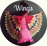 Cute wings idea. Might work well sewn onto a long sleeved top, then you don't need the finger elastic.