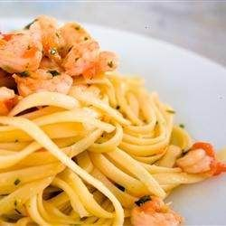 shrimp are cooked with brandy, white wine, garlic and fresh basil in a butter-olive oil sauce.